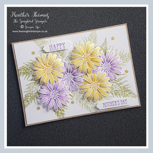 A handmade card with purple and yellow flowers showing how to make a Mother's Day card using the Medium Daisy Punch from Stampin' Up!