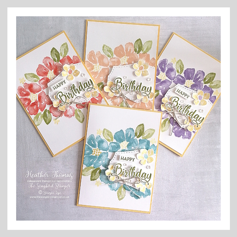 A set of four blossoms in bloom birthday cards