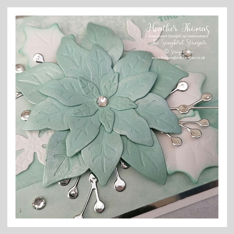 A close up of a handmade Wintry Christmas Card showing the Frost White Shimmer Ink on the petals