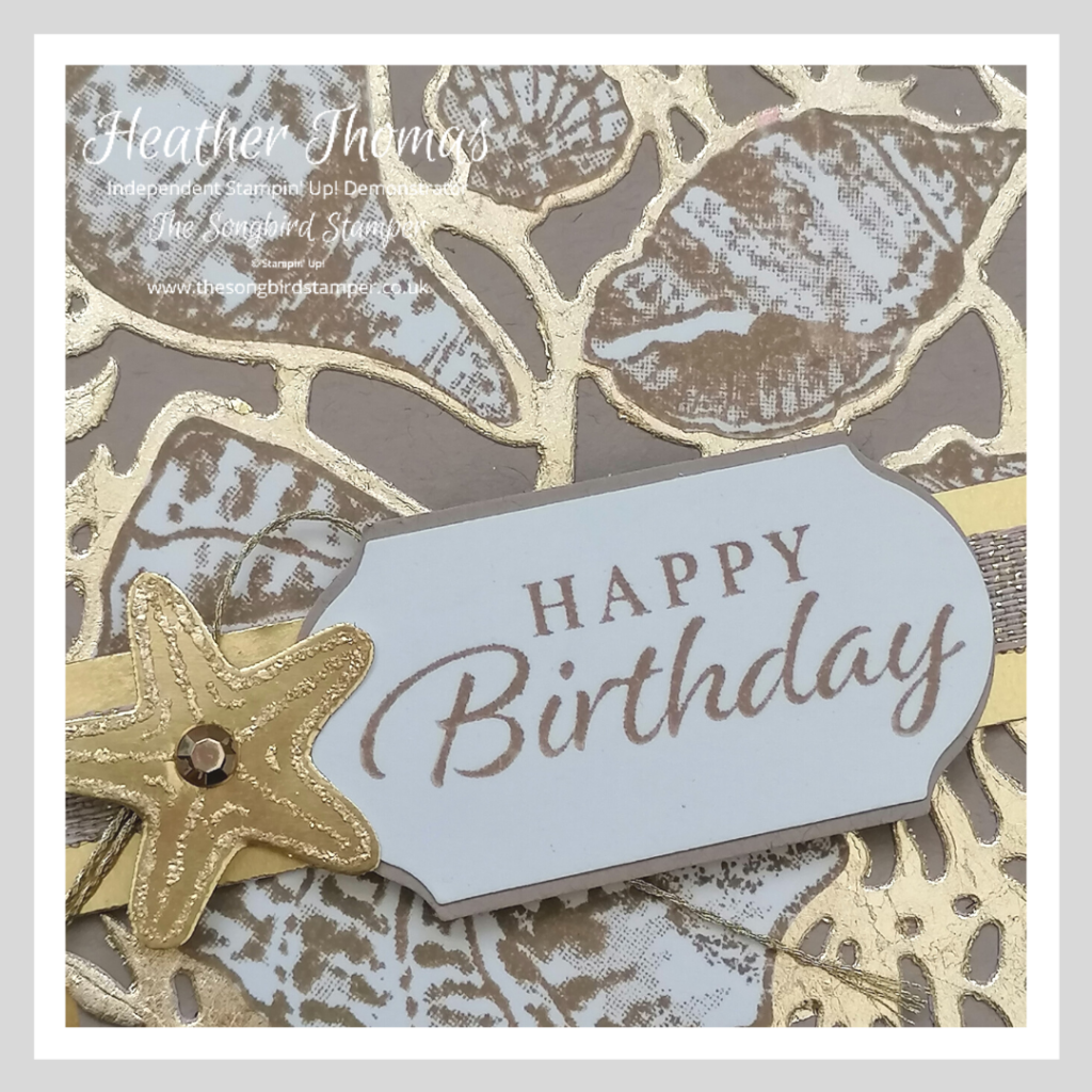 A close up of a handmade birthday card made during the how to use and store gilding flakes video.
