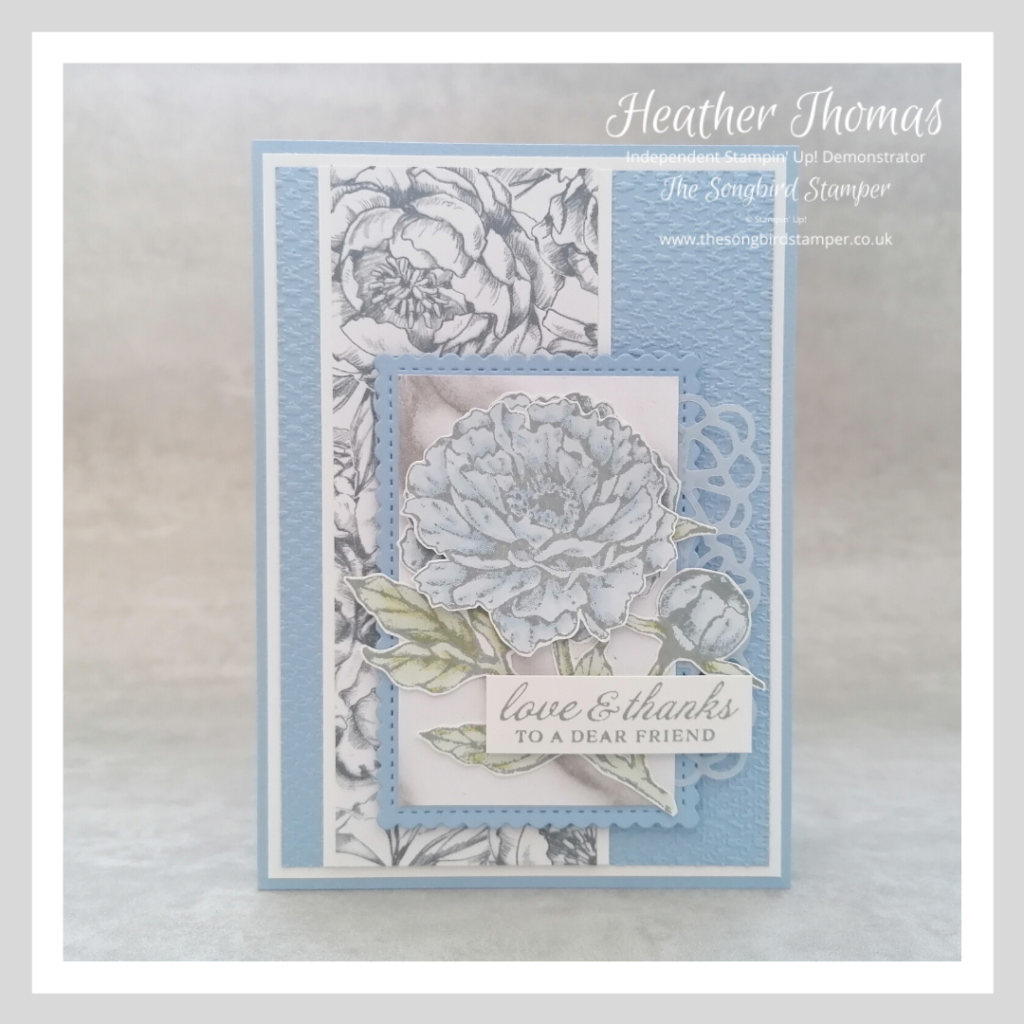 A handmade card made for my how to make a Mother's Day card blog post, with a blue Peony and a subtle grey finish.