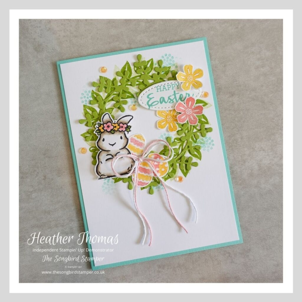 A handmade Easter card in green, pink, orange and blue