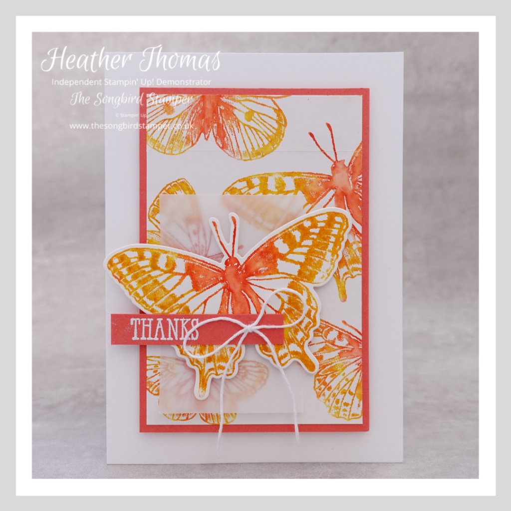 A bright and beautiful orange and yellow handmade card with butterflies on it, made using an easy watercolour effect.