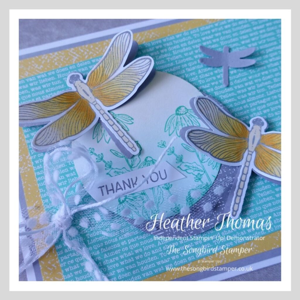 A close up of a handmade card with dragonflies in grey, turquoise and yellow, showing how easy and fun it can be creating from a sketch challenge
