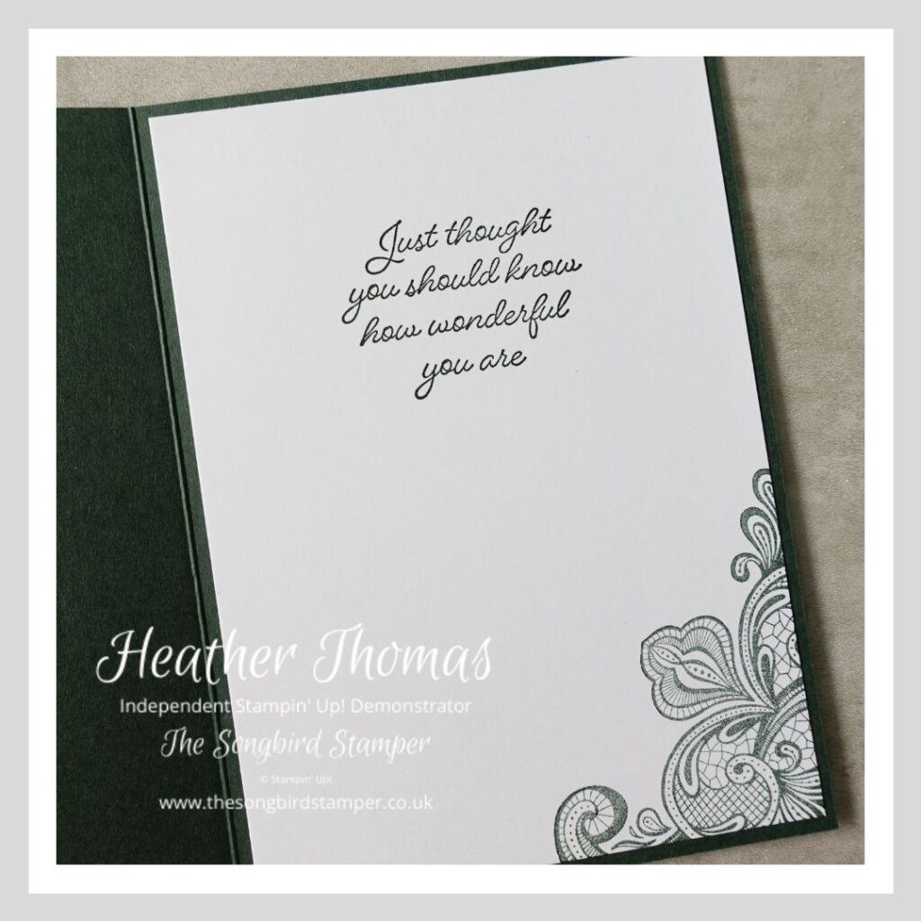 The inside of a handmade card in a dark rich green, with a sentiment and corner decoration.