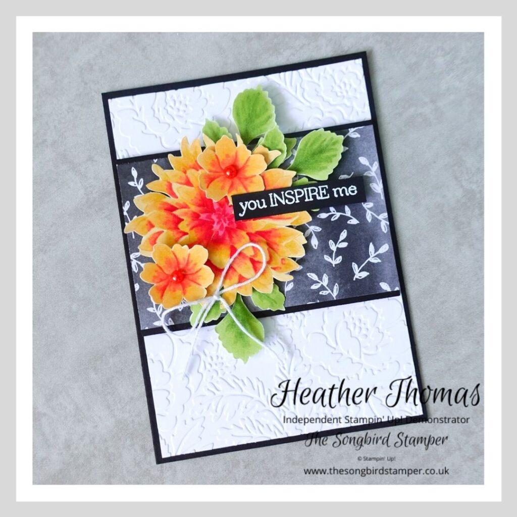 A handmade card with a dahlia image, showcasing the no-line colouring technique.